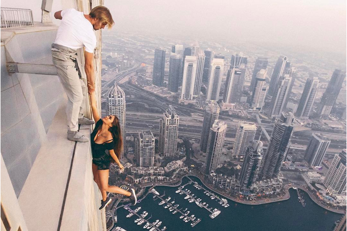 model hangs from dubai tower
