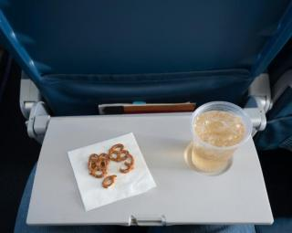 Flight Attendant Reveals What You Should Never Drink On An Airplane